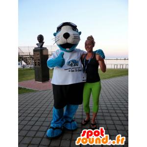 Mascotte del leone di mare blu e bianco con pantaloncini e una t-shirt