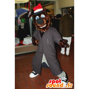 Ruskea koira maskotti pitkä harmaa takki ja hattu - MASFR21499 - koira Maskotteja