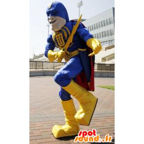 Superhero mascot holding yellow and blue, with a cape - MASFR21508 - Superhero mascot