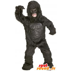 Maskot obří černá gorila, divoce vypadající