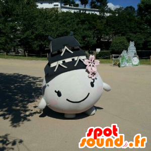 Mascotte cualquier ronda y sonriente con un techo sobre su cabeza - MASFR21518 - Cabezas de mascotas