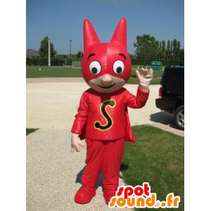 Mascota super héroe con una máscara y un vestido rojo