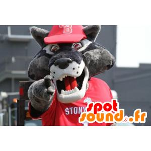Grå vargmaskot, i röd sportkläder - Spotsound maskot