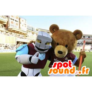 2 mascottes, un ours marron et un robot blanc, bleu et mauve