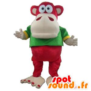 Mascot czerwony i beżowy małpy z zielonym i żółtym koszuli
