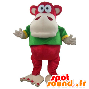 Maskotti punainen ja beige apina vihreä ja keltainen paita