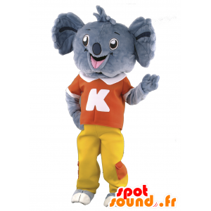 Gray koala mascot dressed red and yellow