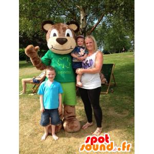 Ruskea nalle maskotti vihreä hallussa - MASFR22001 - Bear Mascot