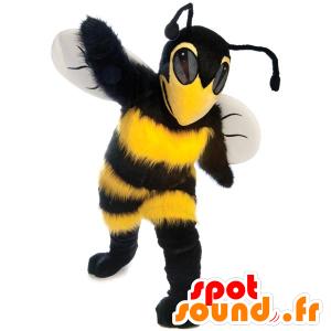Kaunis keltainen ja musta maskotti, mehiläinen, ampiainen