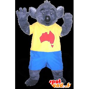 Grijs koala mascotte in blauw en geel outfit