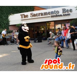 Mascot av svart og gul bie, søt