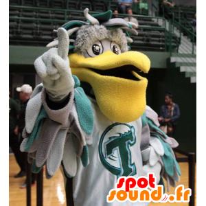 Maskotti harmaa ja vihreä pelikaani isolla keltainen nokka