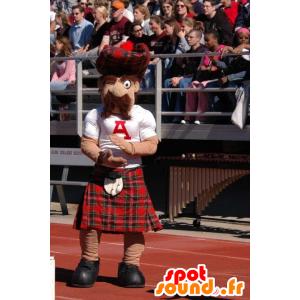 Mascotte d'écossais moustachu en kilt à carreaux