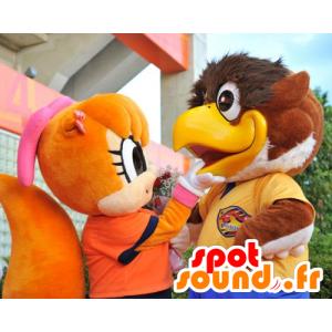 2 maskoter, en stor brun fugl og et ekorn oransje - MASFR22111 - Mascot fugler