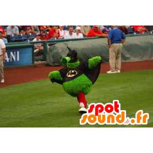 Green monster mascot, all hairy, dressed as Batman - MASFR22129 - Monsters mascots