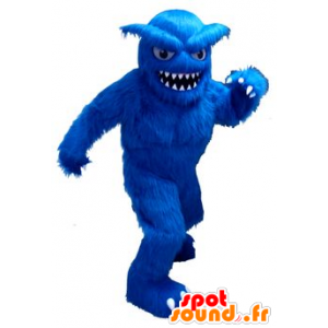 Mascot yeti azul, todo peludo, con grandes dientes