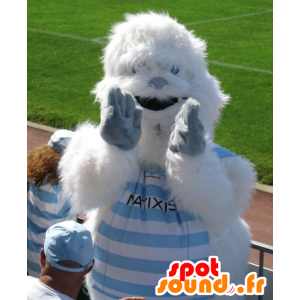 Mascota del yeti blanco y azul, mientras peluda