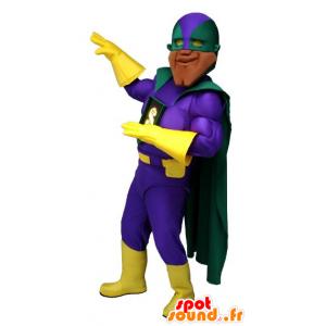 Molto muscoloso supereroe mascotte, con un vestito colorato