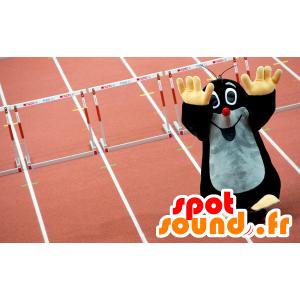Mascot taupe zwart en grijs, leuk en glimlachend