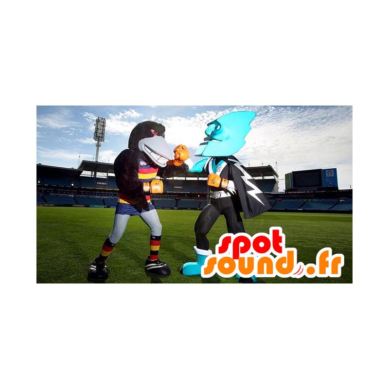 2 mascottes, un corbeau noir et un super-héros tout bleu - MASFR22314 - Mascotte de super-héros
