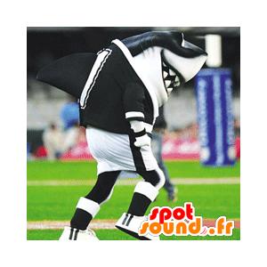 Mascotte de requin noir et blanc, en tenue de sport
