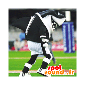 Maskottchen schwarzen und weißen Hai in der Sportkleidung