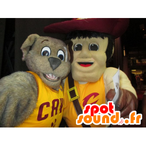 2 pets, a gray dog and a man with a big hat - MASFR22495 - Dog mascots