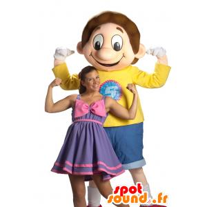 Boy mascotte, gekleed in blauw en geel lachend schooljongen