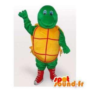 Mascotte de tortue vert jaune et rouge. Costume de tortue