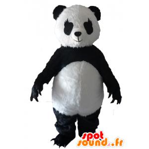 Schwarze und weiße Panda-Maskottchen mit großen Klauen