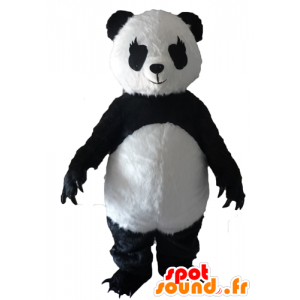 Zwart en wit panda mascotte met grote klauwen