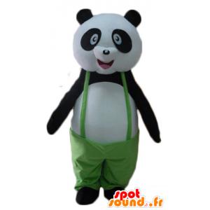 Mascotte de panda noir et blanc, avec une salopette verte