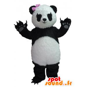 Mascotte de panda noir et blanc, avec un nœud rose