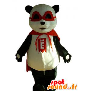 Mascotte de panda noir et blanc avec un masque et une cape rouge