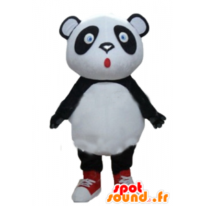 Grande mascote panda preto e branco, olhos azuis