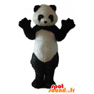 Mascotte di panda in bianco e nero, mentre peloso