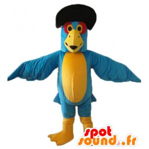 Mascotte de perroquet bleu et jaune, avec un chapeau noir