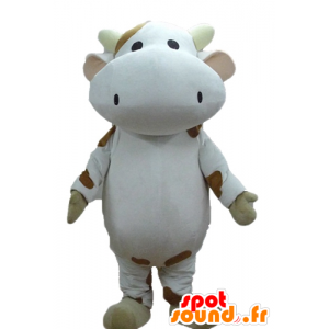 White cow mascot and brown...
