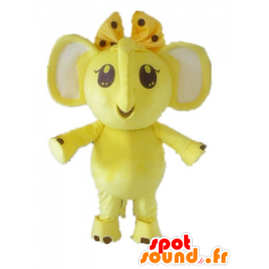 Mascot yellow and white elephant with a bow on her head