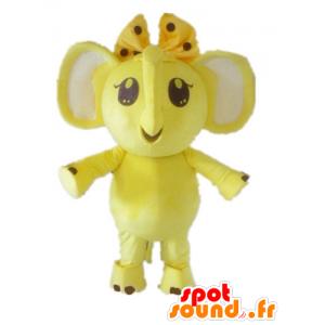 Mascotte gele en witte olifant met een strik op haar hoofd