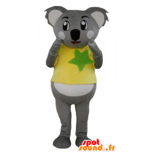 Mascot koala gray and white, with a yellow and green shirt