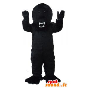Maskot černá gorila, divoce vypadající