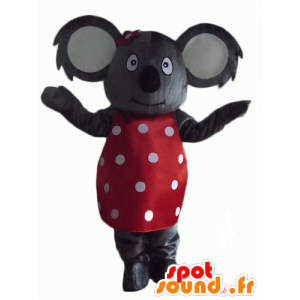 Gray koala mascot with a red dress with white dots