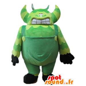 Green monster mascot, in overalls, very big and funny - MASFR23250 - Monsters mascots