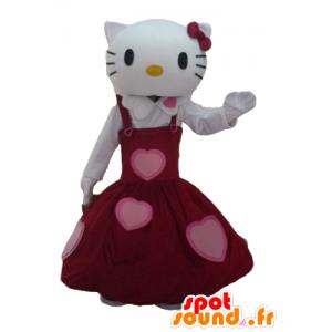 Mascote Olá Kitty vestida em um vestido vermelho bonito