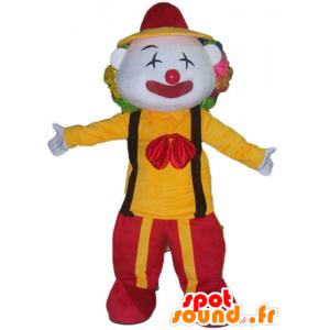 Clown Maskottchen hält rote und gelbe