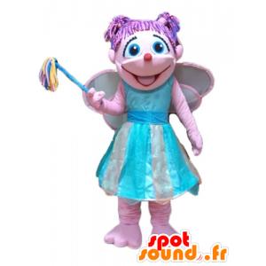 Mascot bastante rosada y azul de hadas, colorido y sonriente