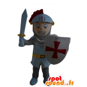 Mascota del muchacho, caballero, con un casco y un escudo