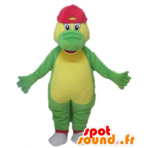 Verde e giallo coccodrillo mascotte con un cappello rosso - MASFR24101 - Mascotte di coccodrilli