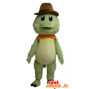 Mascot tortuga verde y naranja, con un sombrero de vaquero